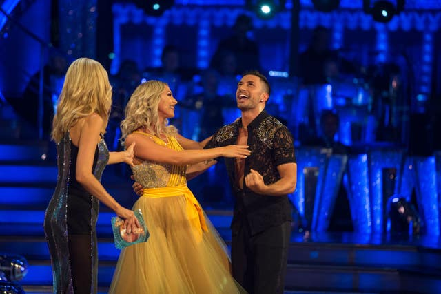 Tess Daly (left) with Faye Tozer and Giovanni Pernice