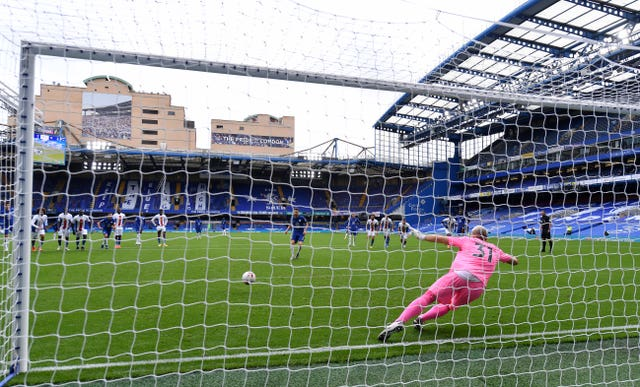 Jorginho, centre, scores the first of Chelsea's two penalties against Crystal Palace on Saturday