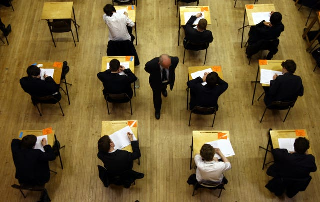 Pupils taking an exam (David Jones/PA)