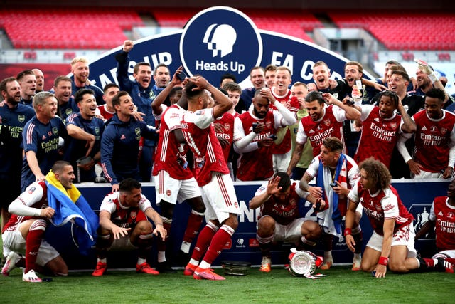 Pierre-Emerick Aubameyang prompts smiles from his Arsenal team-mates after dropping the FA Cup following victory over Chelsea in August's behind-closed-doors final. Gunners captain Aubameyang scored both of his side's goals in a 2-1 comeback win over Frank Lampard's Blues at Wembley before making more headlines courtesy of his blunder