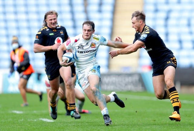 Exeter's Tom Wyatt is tackled by Wasps' Josh Bassett at the Ricoh Arena