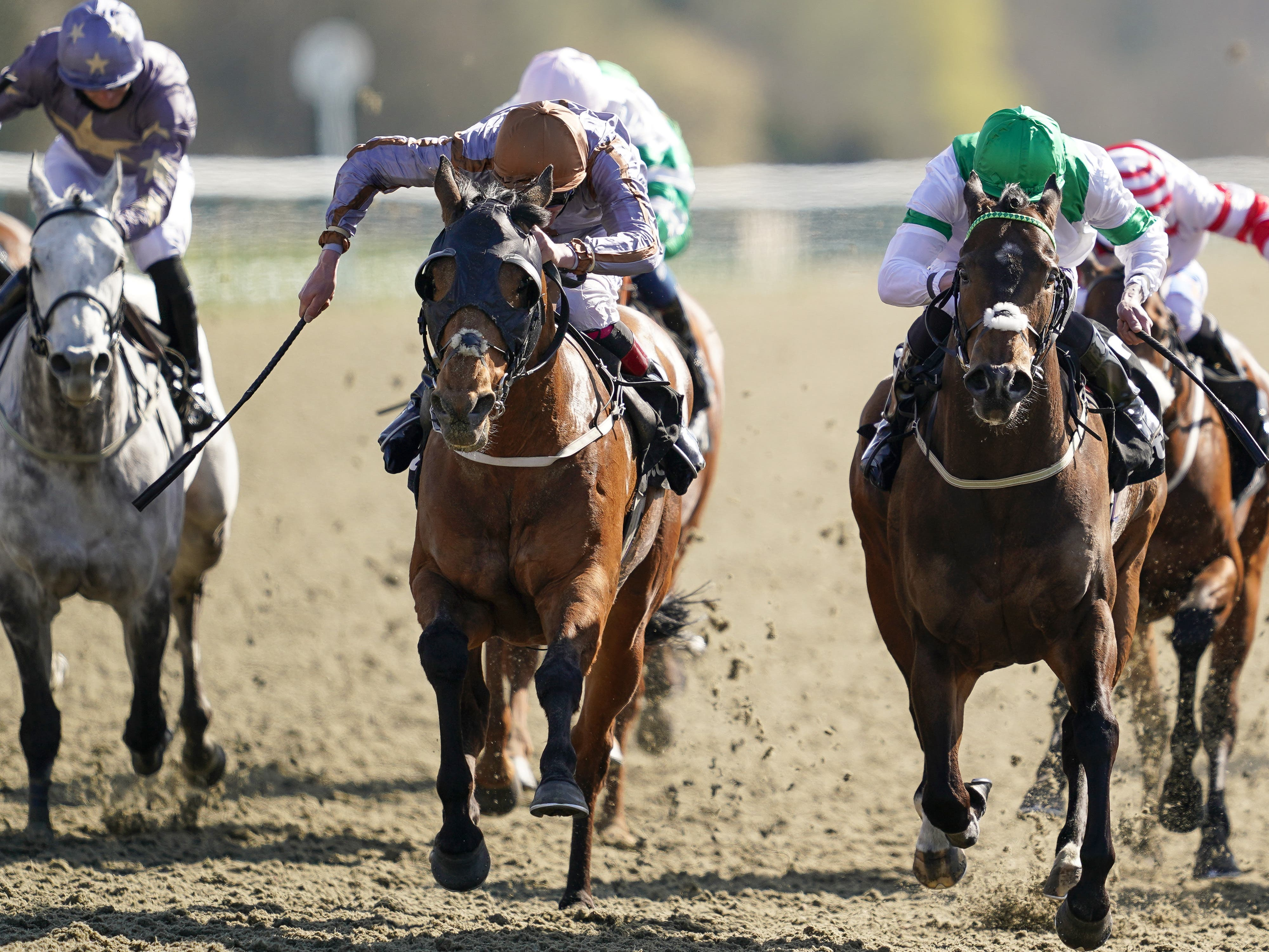 Summerghand (centre) won the Betway All-Weather Sprint Championships (Alan Crowhurst/PA)