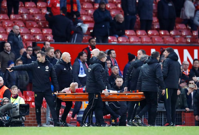 Scott McTominay is carried off the pitch