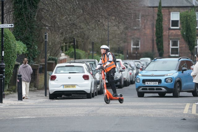 A man rides an e-scooter in Jesmond, Newcastle
