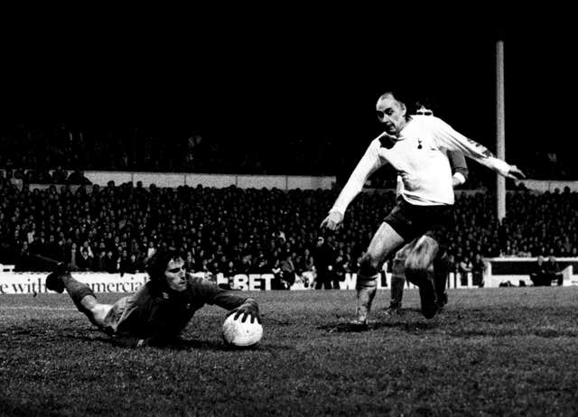 Ray Clemence dives at the feet of Tottenham's Alan Gilzean