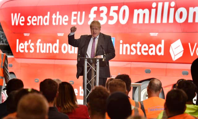 Boris Johnson campaigns in front of the battle bus during the EU referendum