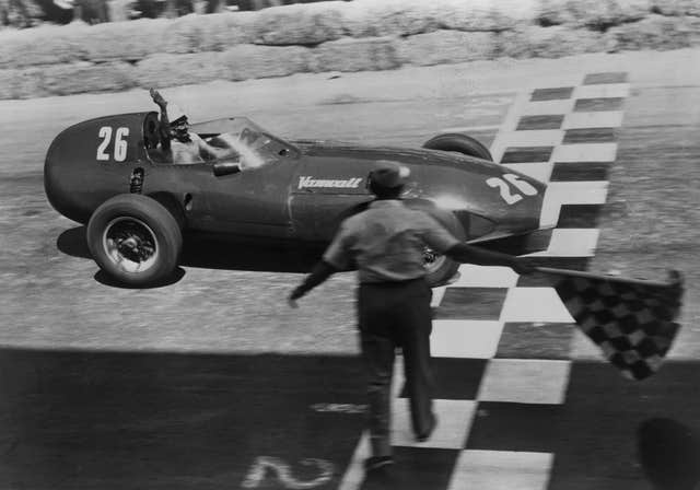 Stirling Moss rcrosses the finish line to win the Pescara Grand Prix in Italy