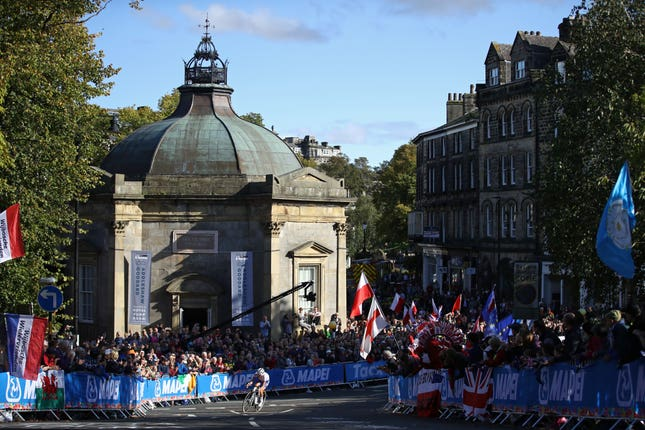 Lizzie Deignan rides by the pump room in Harrogate