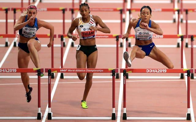 USA's Annie Kunz, Belgium's Nafi Thiam and Johnson-Thompson, right, compete in the women's heptathlon 100m hurdles