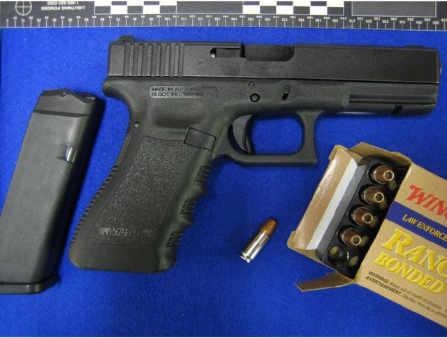 A Glock pistol and ammunition shown in evidence during the trial of Kyle Davies