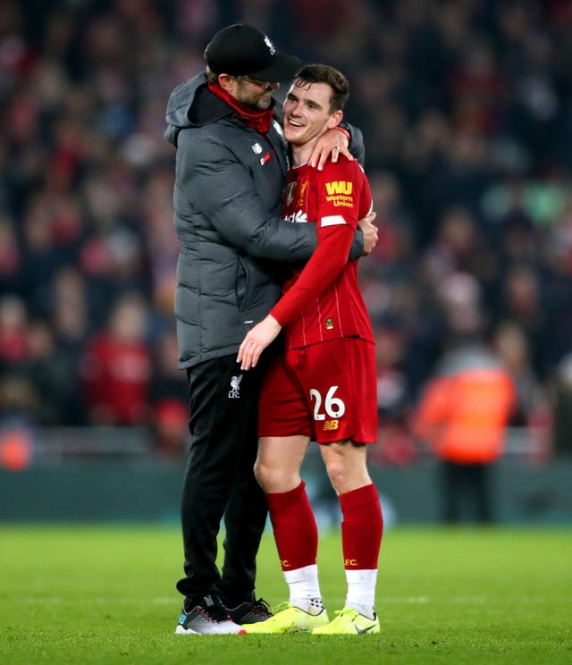 Liverpool manager Jurgen Klopp (left) hugs Andy Robertson