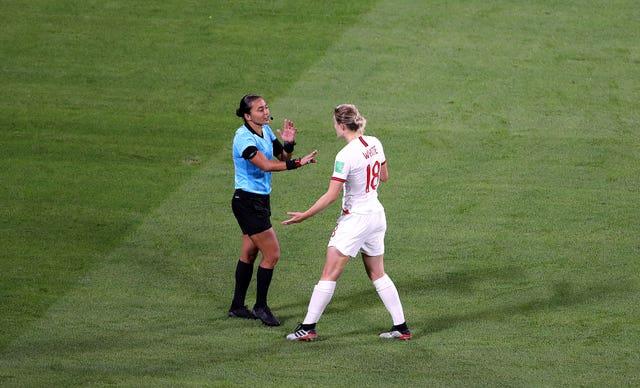 White argues the decision with referee Edina Alves