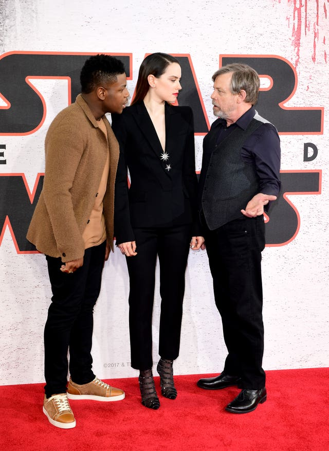 John Boyega and Daisy Ridley with Mark Hamill (Ian West/PA)