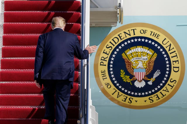 President Donald Trump boards Air Force One (Susan Walsh/AP)