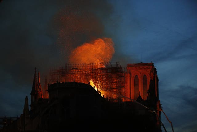 Firefighters tackle the blaze at Notre Dame Cathedral