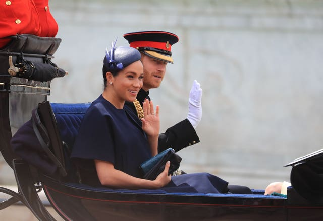 Harry and Meghan make their way to Horse Guards Parade