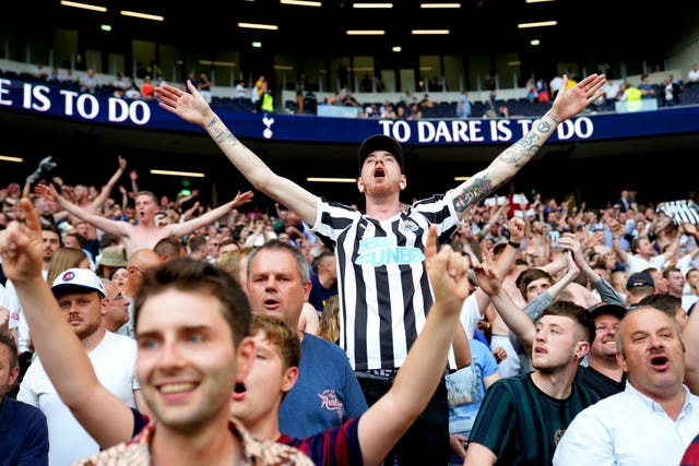 Newcastle fans celebrate their surprise win at Tottenham