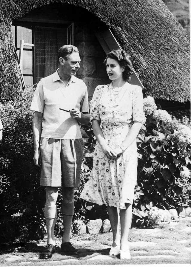 King George VI - whose first name was Albert - with his daughter Princess Elizabeth, now Elizabeth II (PA)