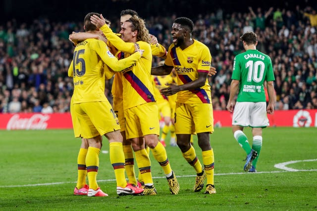 Clement Lenglet is congratulated by Barcelona team-mates at Betis