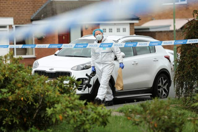 A police forensic officer outside a property on Northdown Road in Solihull, where the mother and daughter were stabbed to death (Aaron Chown/PA)
