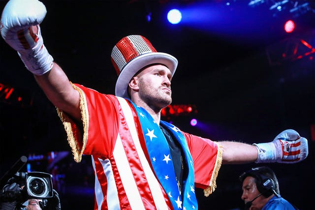 Tyson Fury confidently entered the arena with shades of Rocky Balboa and Uncle Sam