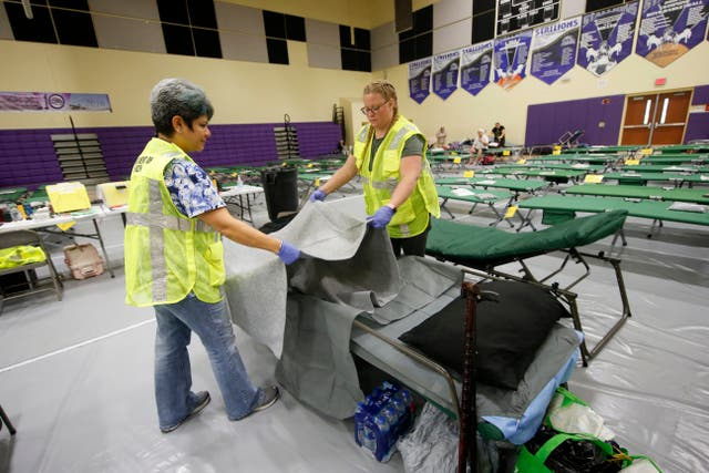 Beds are set up at an evacuation shelter for people with special needs in Florida