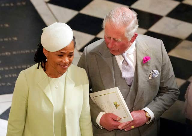 Father of the groom the Prince of Wales and mother of the bride Doria Ragland in the chapel following the wedding (Owen Humphreys/PA)