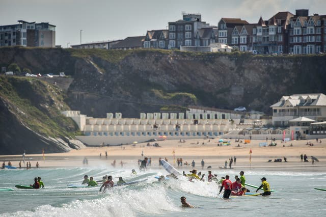 Surfers enjoying the sunshine on Great Western beach in Newquay, Cornwall (Ben Birchall/PA)