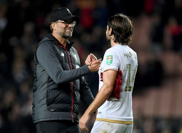 Jurgen Klopp (left) saw his side ease through