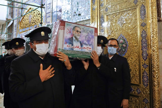 People carry the flag-draped coffin of Mohsen Fakhrizadeh