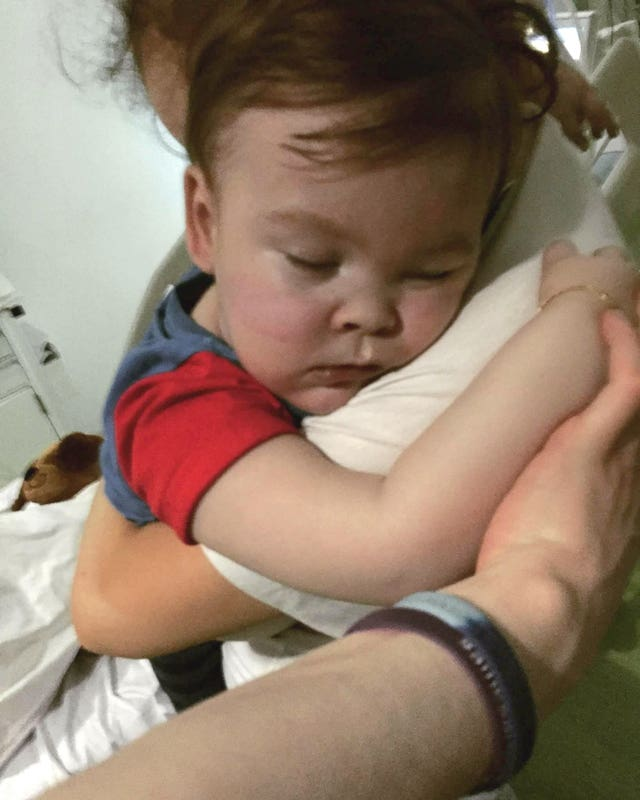 Alfie Evans cuddling his mother Kate James at Alder Hey Hospital (Family handout/Alfies Army/PA)