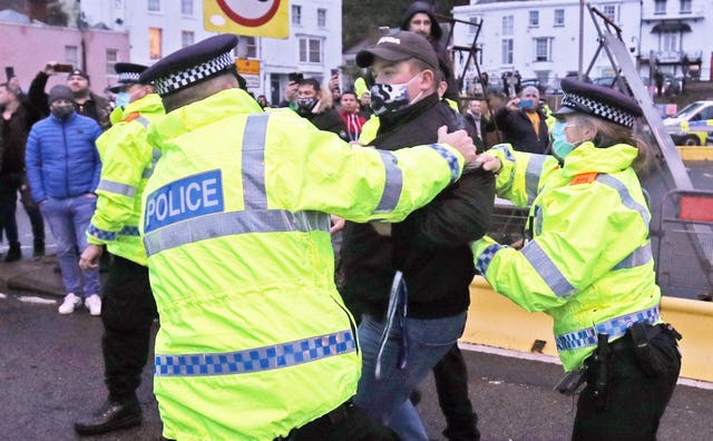 Police hold back drivers trying to enter the Port of Dover in Kent a(Steve Parsons/PA)