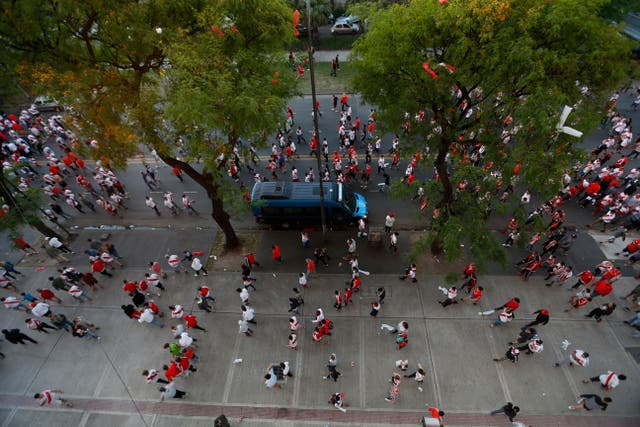 River fans leave the stadium after the match is postponed by 24 hours (Natacha Pisarenko/AP).