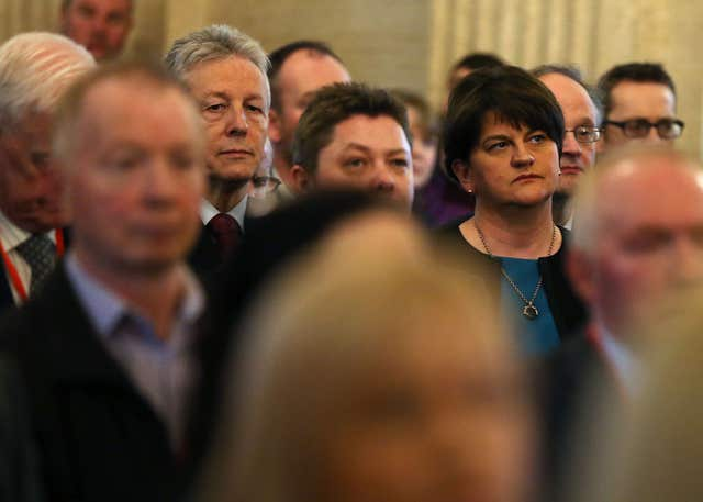DUP leader Arlene Foster (right) and former leader Peter Robinson attend the unveiling of a portrait of former deputy first minister Martin McGuinness in the Great Hall of Parliament Buildings, Stormont (Brian Lawless/PA)