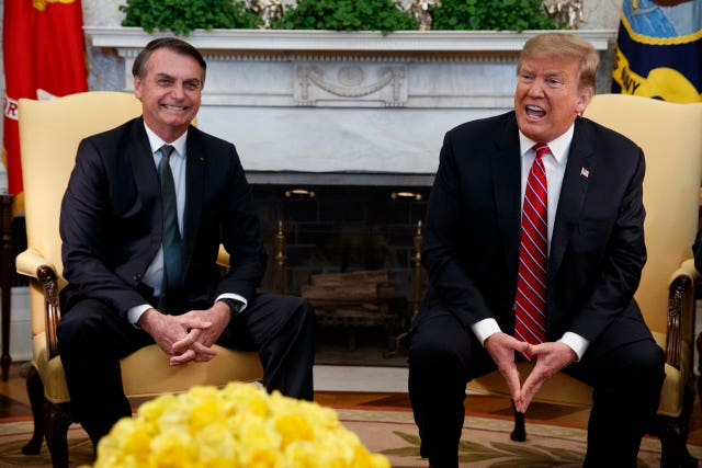Donald Trump speaks during a meeting with Jair Bolsonaro in the Oval Office