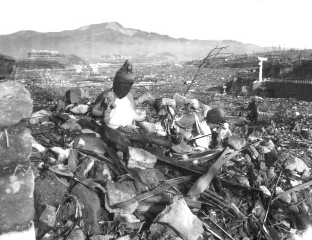 A battered religious figure on a hill above a burn-razed valley in Nagasaki, Japan