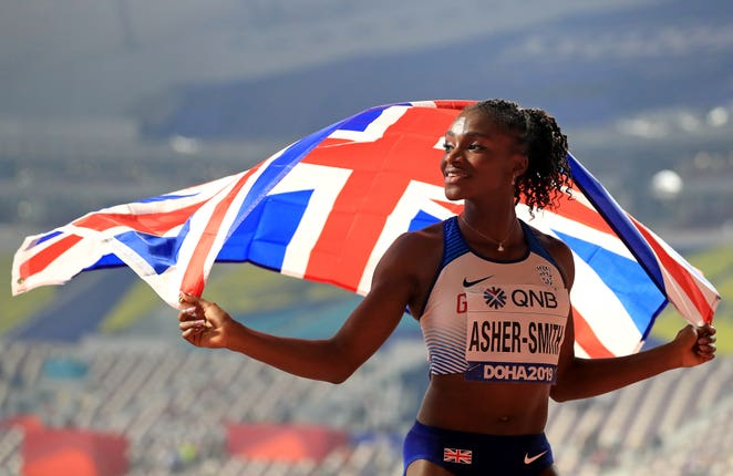 Dina Asher-Smith celebrates the silver medal