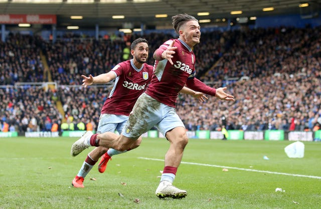 Jack Grealish celebrates scoring Villa's winner having been punched by spectator Paul Mitchell earlier in the game