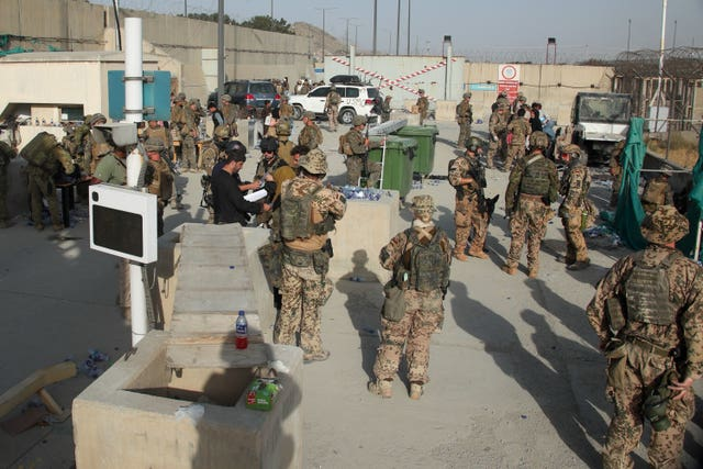 British and US military assist in evacuating people from Kabul