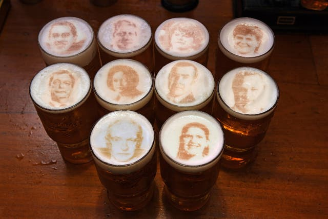 Pints of beer with the faces of political leaders in the foam, which will be available from Tuesday at Greene King's Two Chairmen public house in Westminste