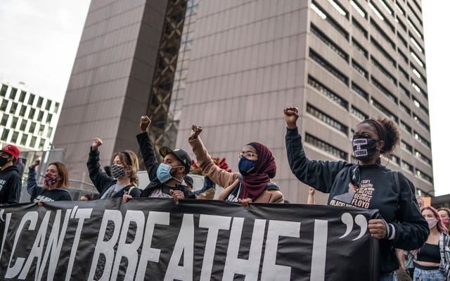 Demonstrators marched past the Hennepin County Government Centre one day before jury selection is set to begin in the trial of former Minneapolis officer Derek Chauvin, who is accused of killing George Floyd in Minneapolis, Minnesota