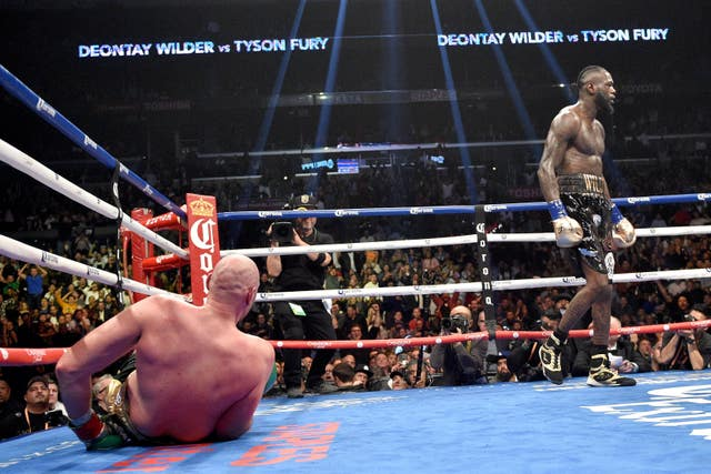 Deontay Wilder knocks down Tyson Fury during the WBC heavyweight world title fight