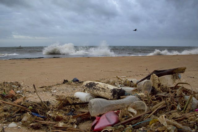 A plastic bottle lies among other debris washed ashore on an Indian Ocean beach north of Colombo, Sri Lanka