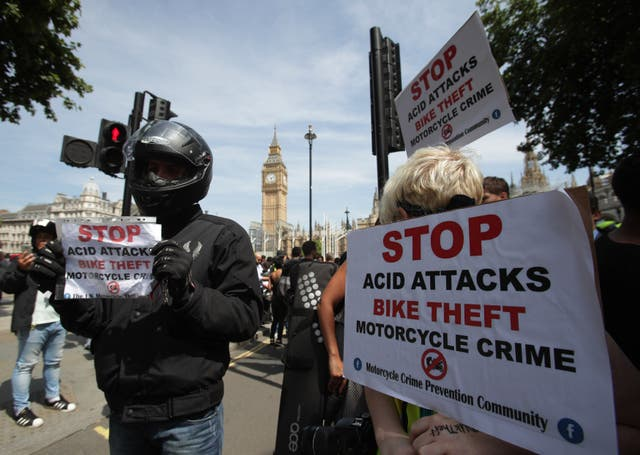 Food delivery riders demonstrated in Parliament Square following moped acid attacks after five separate male victims were targeted in the north and east of the capital (Yui Mok/PA)