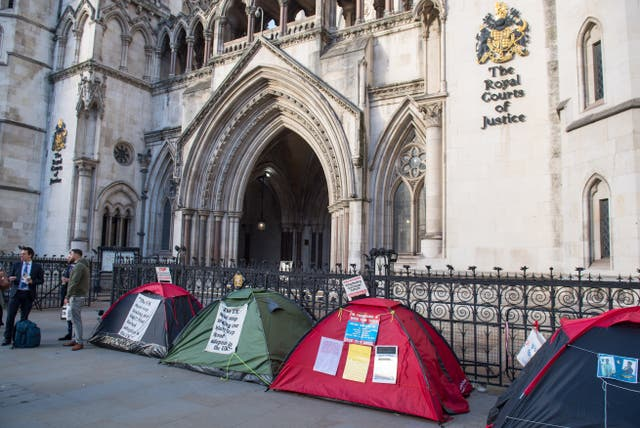 Demonstrators are camping outside the Royal Courts of Justice