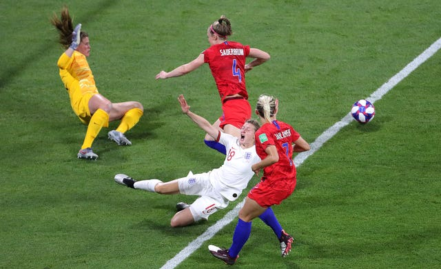 White was fouled by Becky Sauerbrun as England were awarded a penalty after a VAR decision