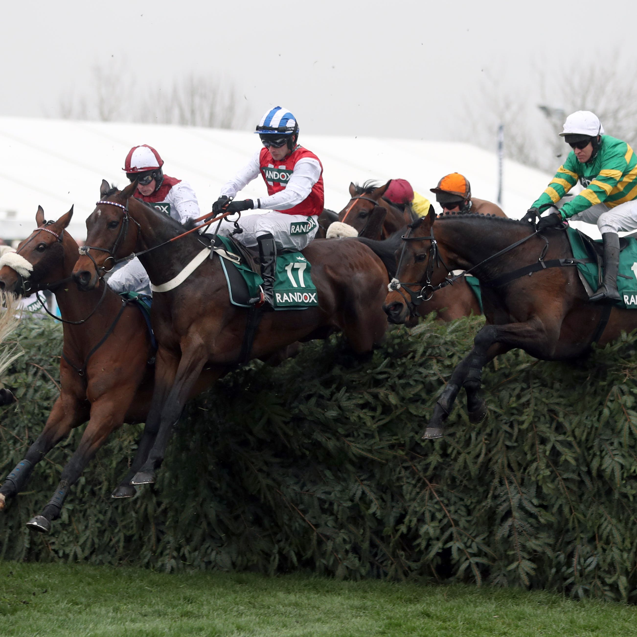 Horses take a fence in the Topham Chase which is the target for Ross O'Sullivan's Call It Magic