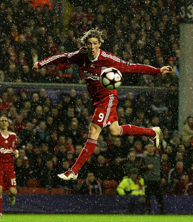 Torres is airborne during a 2-1 home Champions League defeat by Fiorentina in December 2009