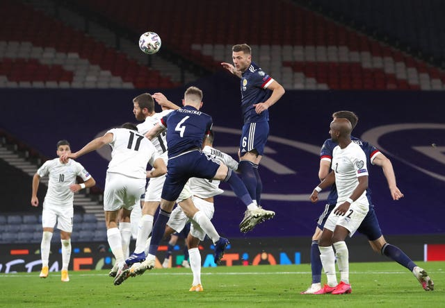 Liam Cooper, centre top, sustained a calf injury while on duty for Scotland