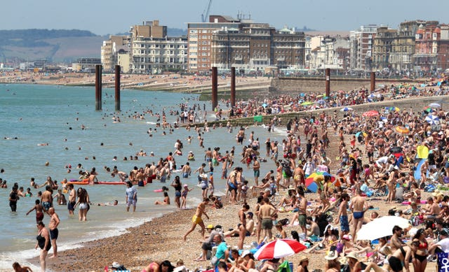 Some British beaches were packed this week but now foreign holidays are back on the cards (Gareth Fuller/PA)